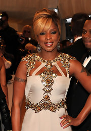 Mary J. Blige was aglow on the red carpet at the 2011 Met Gala. The songstress swept her blond tresses up in a sleek French twist.