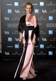 Eva Herzigova slipped into an asymmetrical pink and black satin gown by Alexander McQueen for the Savage Beauty private view.