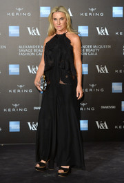 Meg Mathews looked sultry in a sheer-panel black halter gown at the Alexander McQueen: Savage Beauty private view.