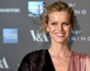 Eva Herzigova pulled her hair back into a messy-glam updo, adorned with a cherry blossom headpiece, for the Alexander McQueen: Savage Beauty private view.