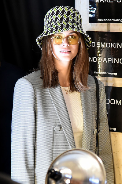 Kaia Gerber kept it youthful in a printed bucket hat by Prada at the Alexander Wang fashion show.