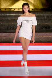Kaia Gerber showed off her long, lean legs in a white off-the-shoulder mini dress at the Alexander Wang runway show.