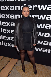 Paloma Elsesser continued the dark theme with a pair of sheer black tights.