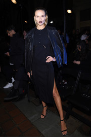 Natasha Poly wore a little black dress with perforated detailing to the Alexander Wang fashion show.