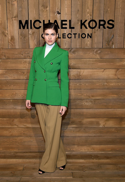 Alexandra Daddario Blazer [green,clothing,fashion,outerwear,pantsuit,fashion model,coat,suit,fashion design,jacket,alexandra daddario,front row,new york city,michael kors fw20 runway show,alexandra daddario,new york fashion week,fashion show,fashion,new york,getty images,haute couture,fashion week,actor]