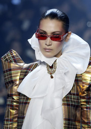 Bella Hadid rocked red shades on the Alexandre Vauthier Couture runway.