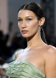 Bella Hadid wore her hair in a simple center-parted ponytail at the Alexandre Vauthier Couture Spring 2020 show.