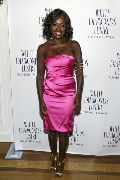 Viola Davis kept up the electrifying vibe all the way down to her gold ankle-strap sandals.