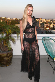 Stella Maxwell worked her supermodel figure in a sheer black maxi dress by Alice McCall during the label's SS18 launch.