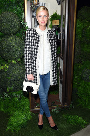 Nicky Hilton kept it classy in a black-and-white tweed jacket by Alice + Olivia during the brand's fashion show.