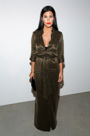 Kourtney Kardashian kept it classy in a wide-leg satin jumpsuit by Alice + Olivia when she attended the brand's presentation.