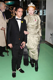 Vivienne Westwood attended the premiere of 'Alice in Wonderland' wearing an elegant gold evening dress and, in true Westwood fashion, chunky mid-calf boots.