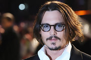 Wondering how to dress for a 'Royal World Premier'?  Take a cue from the ever-so-cool Johnny Depp.  Here he wore his hair in a medium length with a center part, sported a goatee, and topped off the look with blue tinted glasses.