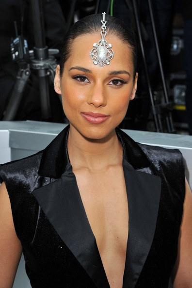 Alicia Keys Headdress [hair,eyebrow,hairstyle,lip,beauty,chin,forehead,black hair,fashion,fashion model,winter 2012,alicia keys,front row,part,ready-to-wear fall,grand palais,paris,chanel,paris fashion week womenswear fall,show]