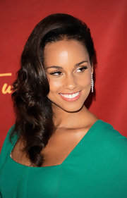 Alicia swept her hair to the side in voluminous curls for the unveiling of her wax figure.
