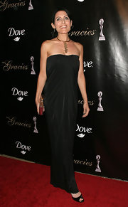 Lisa looks classically elegant in a floor length strapless evening dress.