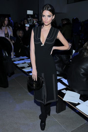 Emily Ratajkowski complemented her dress with a tasseled black python clutch, also by Altuzarra.
