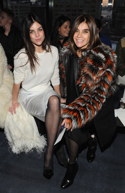 Carine Roitfeld teamed black ankle boots with a colorful fur coat for the Altuzarra fashion show.