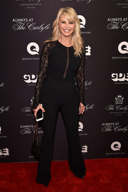 Christie Brinkley showed off her figure in a fitted black jumpsuit with lace sleeves at the premiere of 'Always at the Carlyle.'