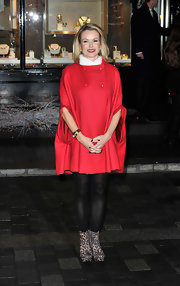 Amanda Holden kept on-trend with leopard ankle boots. She paired the shoes with black opaque tights and a festive red coat.