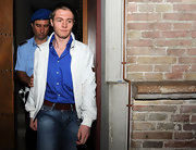 Defendant Raffaele Sollecito wore a beige cropped jacket and jeans to the Amanda Knox appeal.