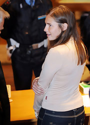 Amanda Knox wore her hair in a simple long straight style for her extended trial in Italy.
