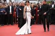 Juliette Binoche looked ageless in a white Armani Prive fishtail gown with a plunging neckline and black trim at the Cannes Film Festival screening of 'Amant Double.'
