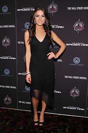 Olivia Culpo's red nail polish added a pop of color to her all black ensemble.