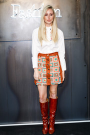 Diana Vickers amped up the retro feel with a pair of red knee-high boots.