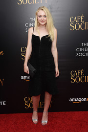 Dakota Fanning injected some shine with a pair of bow-adorned silver sandals.