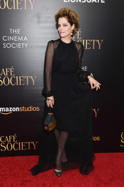 Parker Posey went for classic glamour in a black sheer-overlay gown by Gary Graham at the New York premiere of 'Cafe Society.'