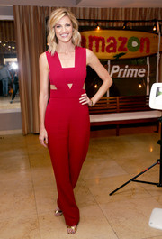 Erin Andrews chose a modern and sexy red cutout jumpsuit by Cushnie et Ochs for the Amazon Prime Summer Soiree.