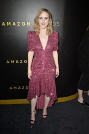 Rachel Brosnahan finished off her look with a pair of plum satin sandals.