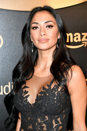 Nicole Scherzinger attended the Amazon Studios Golden Globes celebration wearing a flowing wavy 'do.