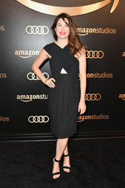 Kathryn Hahn hit the Amazon Studios Golden Globes celebration wearing a little black dress with a crossover bodice and a midriff cutout.