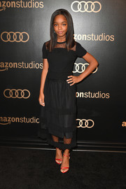 Marsai Martin gave her black look a pop of color with a pair of red satin sandals by Loriblu.