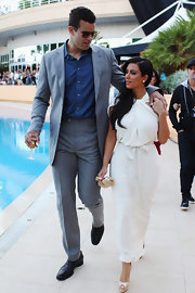 Kris Humphries and Kim K. looked like a chic couple at the Amber fashion show. Kris opted for a light gray suit, casually paired with a crisp blue shirt.