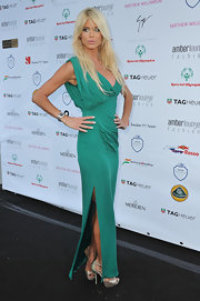 Victoria looked svelte in an emerald evening gown with a thigh-high slit at the Amberlounge event in Monaco.