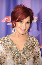 Sharon Osbourne wore a pair of large beaded dangling earrings at the 'AGT' post show red carpet.