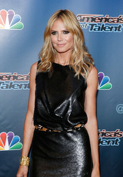 Heidi Klum teamed her sequined LBD with a textured gold cuff for added shimmer during the 'America's Got Talent' red carpet event.