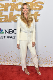Heidi Klum was Western-chic in a fringed cream pantsuit by Zuhair Murad Couture at the 'America's Got Talent' season 13 live show.