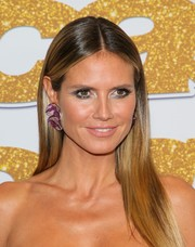 Heidi Klum went for futuristic glamour with a heavy application of silver eyeshadow.