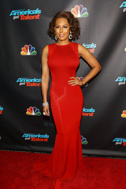 Melanie Brown flaunted her fab curves in a sultry red mermaid gown during the 'America's Got Talent' season 8 pre-show event.