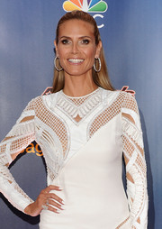Heidi Klum swiped on some white nail polish to match her dress for the 'America's Got Talent' season 9 event.