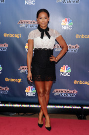 Melanie Brown went the demure route in a black-and-white Valentino lace mini dress when she attended the 'America's Got Talent' season 9 event.
