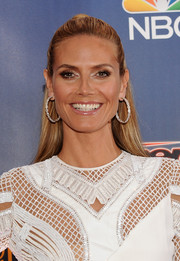 Heidi Klum looked totally glam wearing these massive Lorraine Schwartz diamond hoops at the 'America's Got Talent' season 9 event.