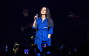 Demi Lovato performed at House of Blues Dallas wearing an electric-blue jumpsuit by Givenchy.
