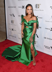 Karrueche Tran got majorly glam in an emerald-green gown with a midriff cutout and a flowing skirt for the American Ballet Theatre 2019 Fall Gala.