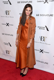 Katie Holmes layered a rust-colored trenchcoat by Altuzarra over a matching dress for the American Ballet Theatre 2019 Fall Gala.