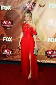 Carrie Underwood paired her knockout crimson gown with gold peep-toes by Rene Caovilla. The glimmering heels were the perfect complement to the stunning red carpet look.